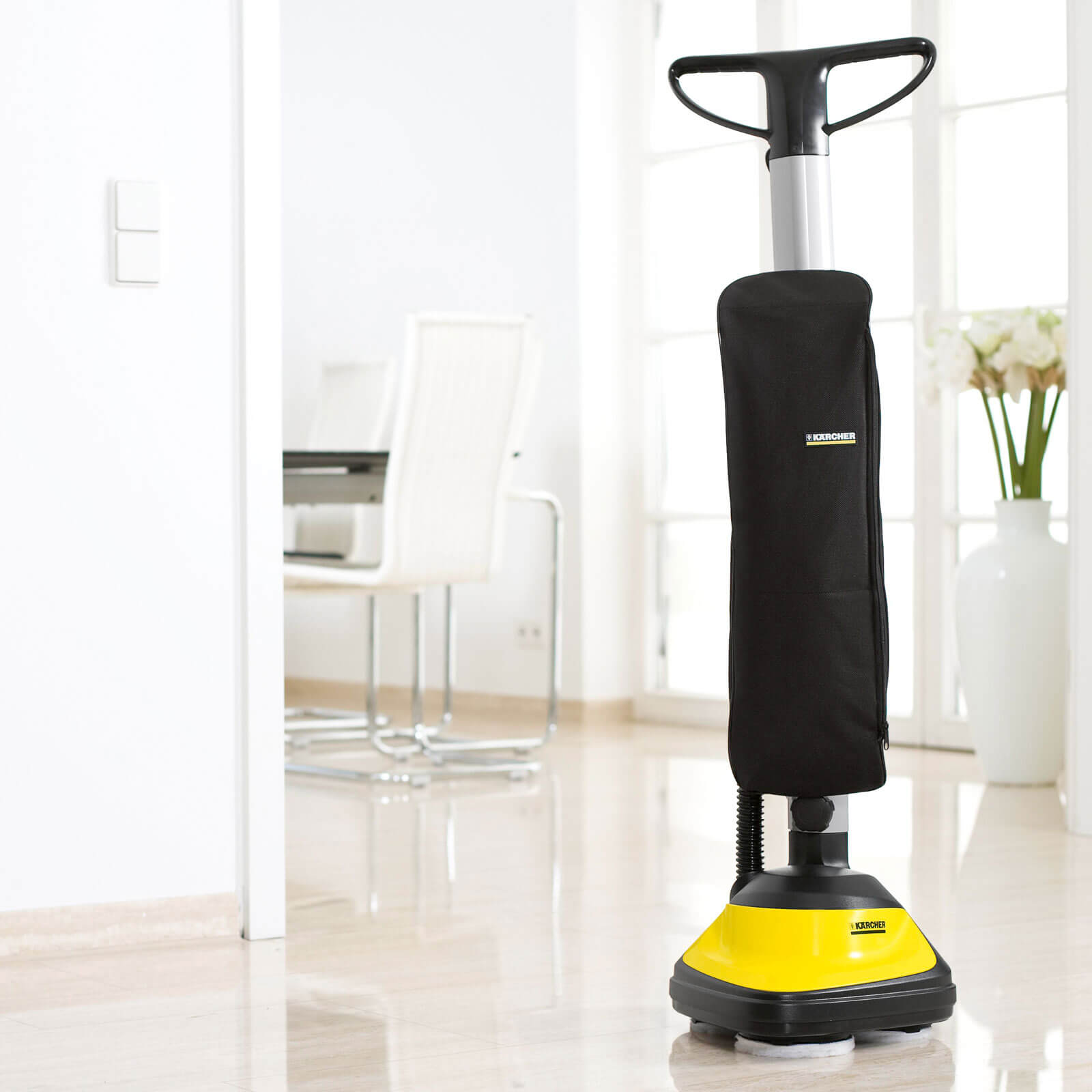 Electric scrubber for tile floors